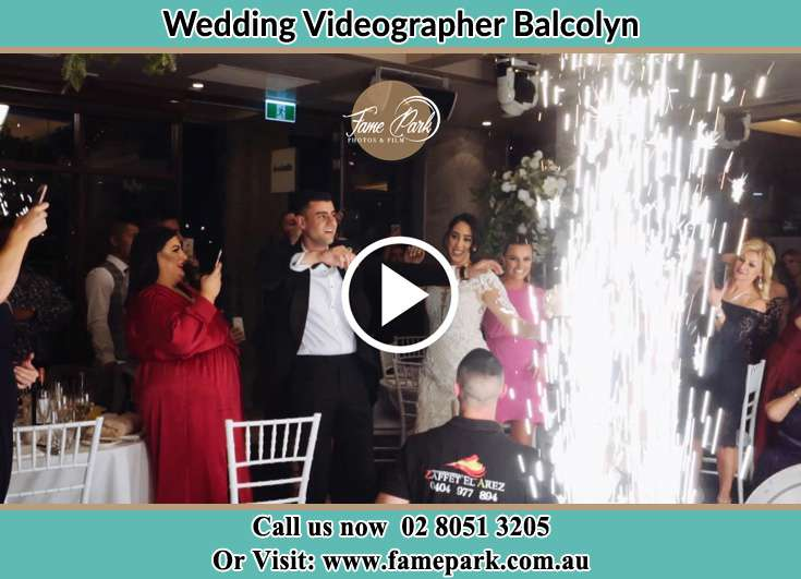 Couple having funny moments at receptionBalcolyn NSW 2264