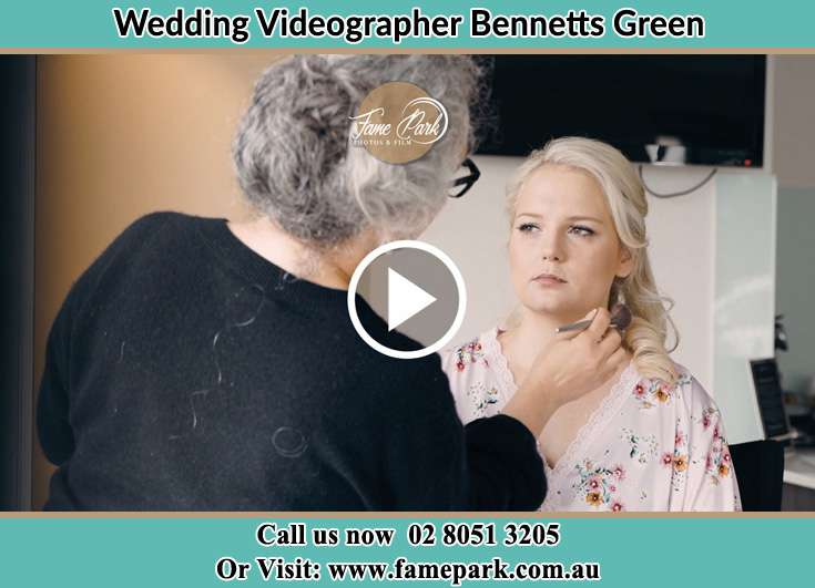 The Bride having a make-up with the help of the makeup artist Bennetts Green NSW 2290