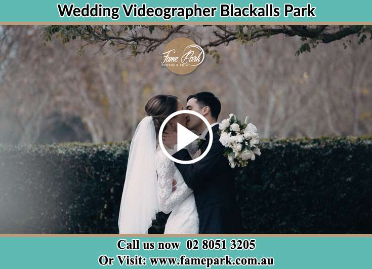 The newly weds kissing Blackalls Park NSW 2283