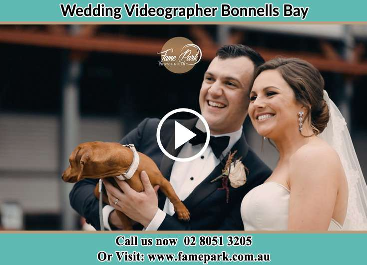 The new couple posed for the camera with their dog Bonnells Bay NSW 2264