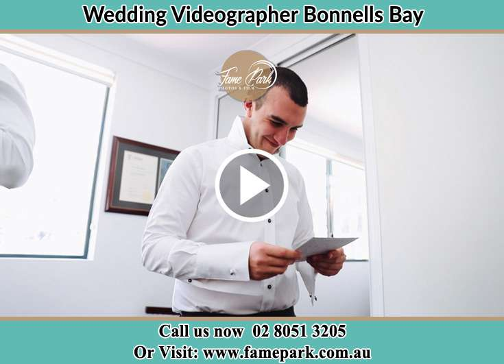 The Groom reading a note Bonnells Bay NSW 2264
