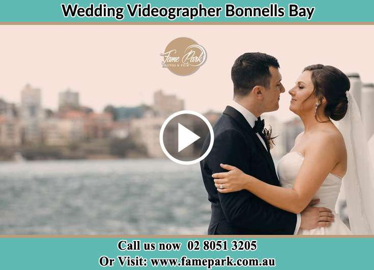 Bride and Groom kissed at the shore Bonnells Bay NSW 2264