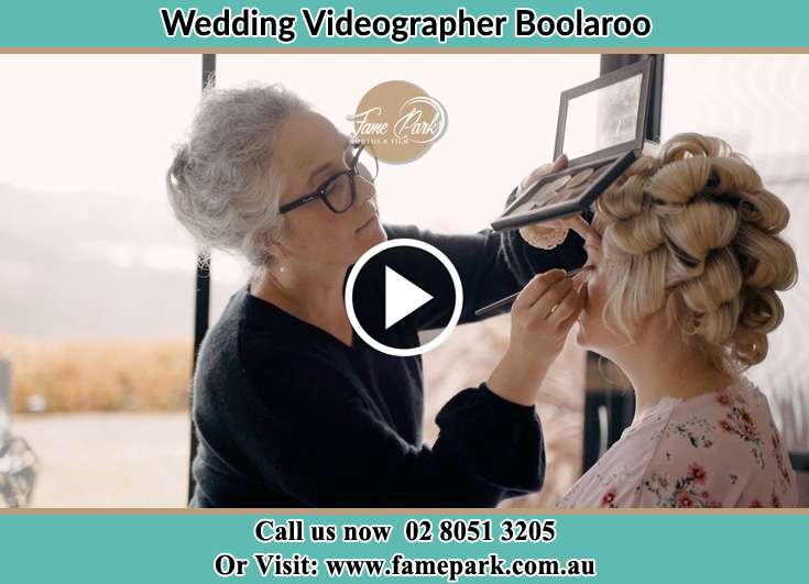 The Bride having a make-up with the help of the makeup artist Boolaroo NSW 2284
