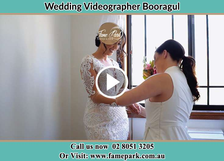 Bride getting ready through the help of her secondary sponsor Booragul NSW 2284