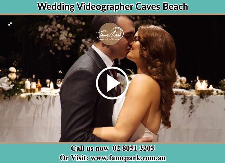 The new couple kissing Caves Beach NSW 2281