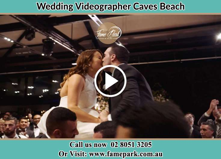 The newly weds kissing Caves Beach NSW 2281