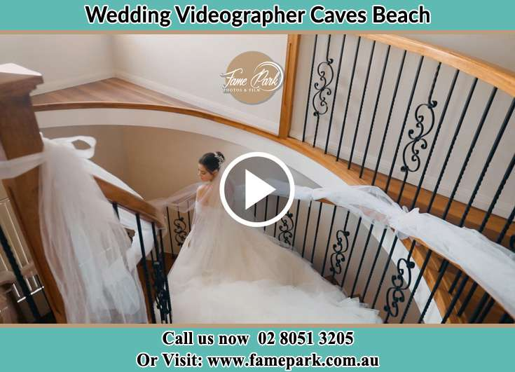 The Bride walking downstairs Caves Beach NSW 2281