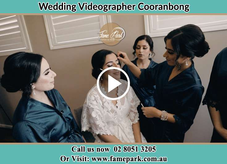 The Bride having a make-up with the help of the makeup artist Cooranbong NSW 2265