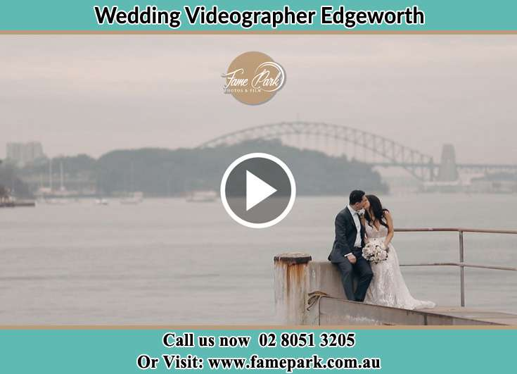 Bride and Groom kissed at the shore Edgeworth NSW 2285