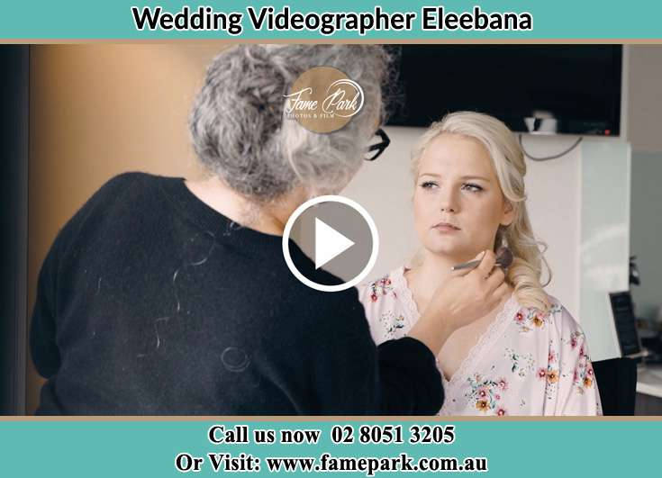 The Bride having a make-up with the help of the makeup artist Eleebana NSW 2282