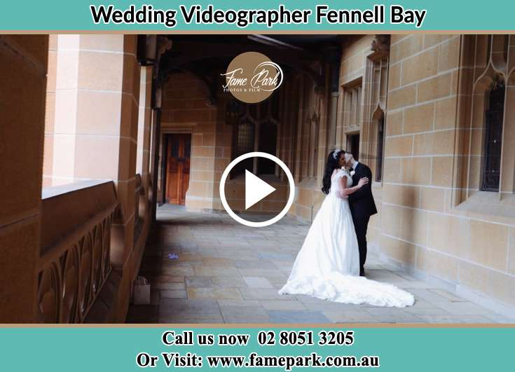 The newly weds kissing at the hall way Fennell Bay NSW 2283