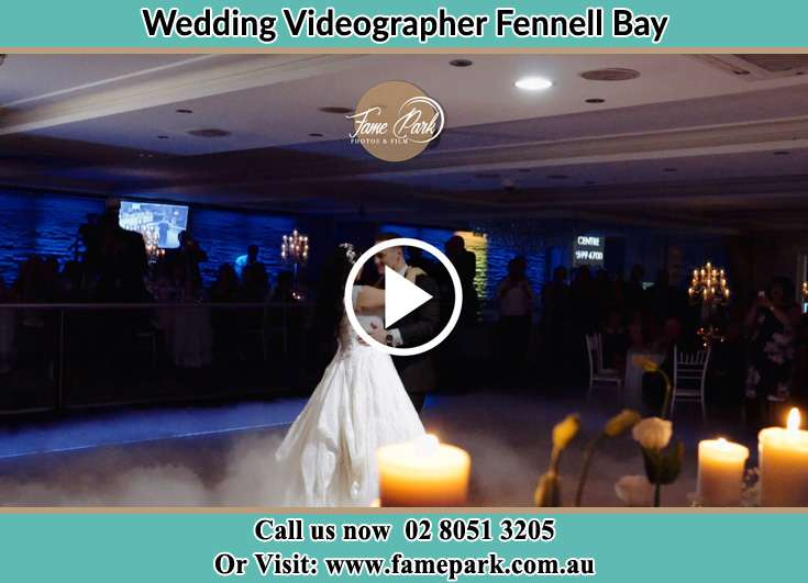 Bride and Groom looking at each other while dancing Fennell Bay NSW 2283