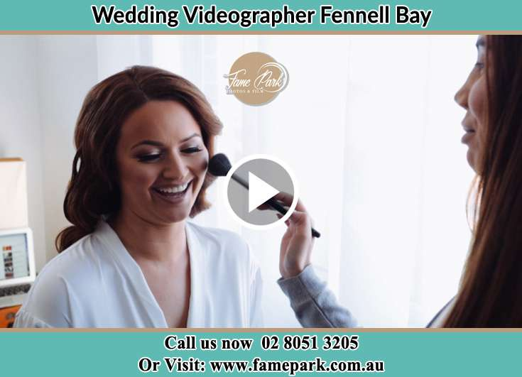 The Bride having a make-up with the help of the makeup artist Fennell Bay NSW 2283