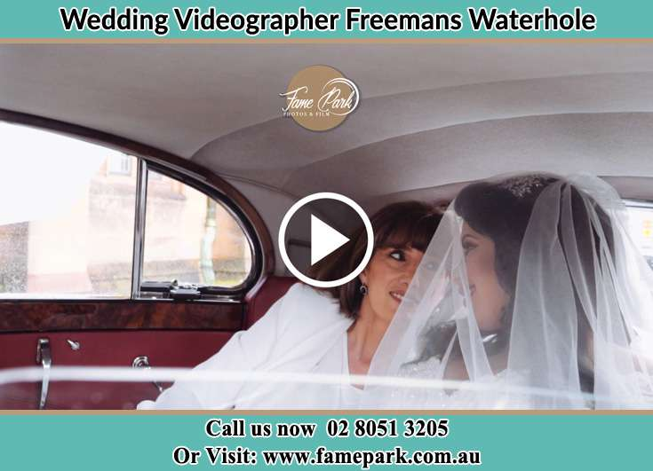 The Bride and her mother inside the wedding car Freemans Waterhole NSW 2323