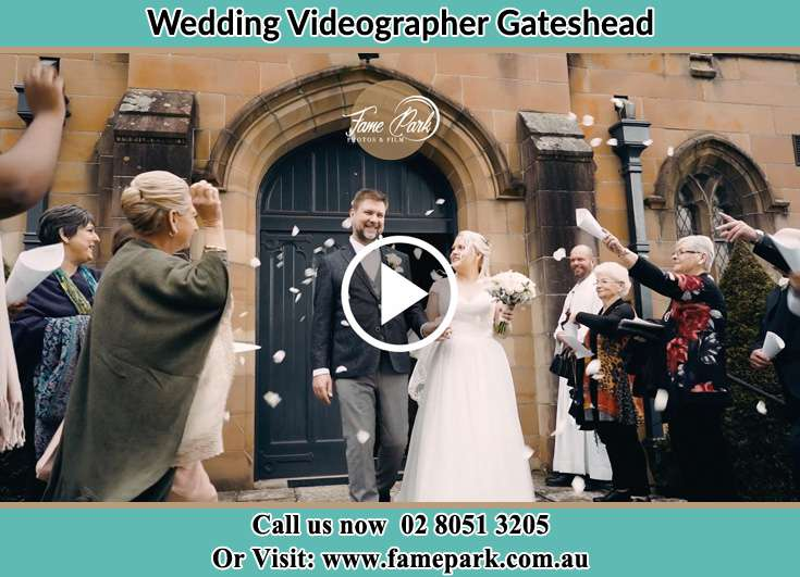 The newly weds walking through the well wishers Gateshead NSW 2290