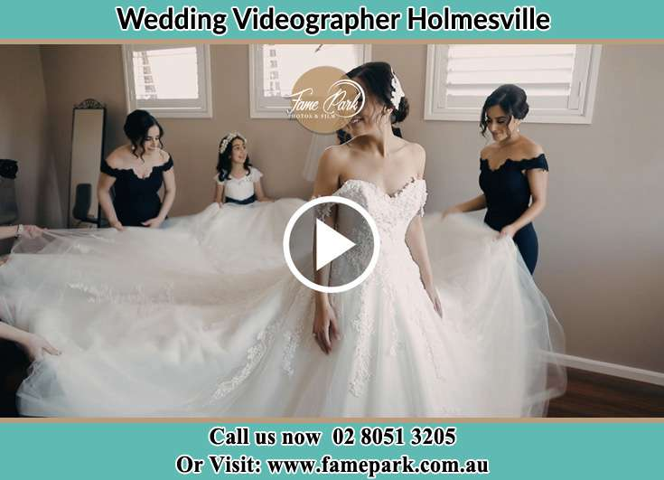 The girls spread out the wedding gown wore by the Bride Holmesville NSW 2286