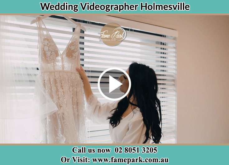 The Bride checking her wedding gown Holmesville NSW 2286