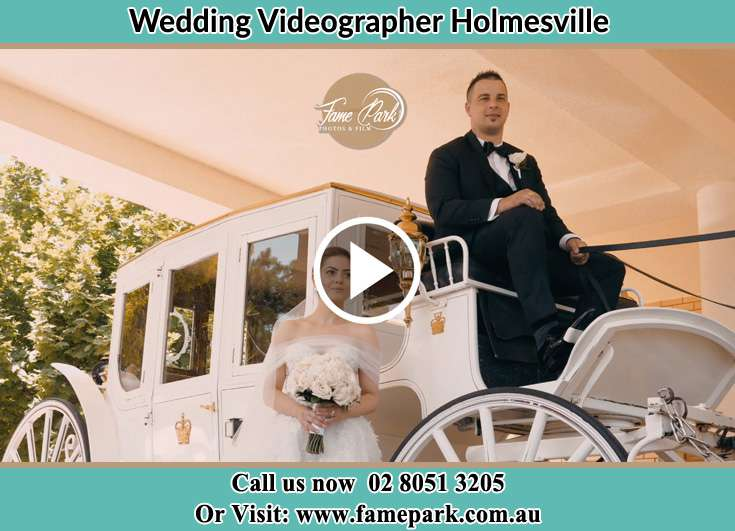 The Bride outside the wedding carriage Holmesville NSW 2286