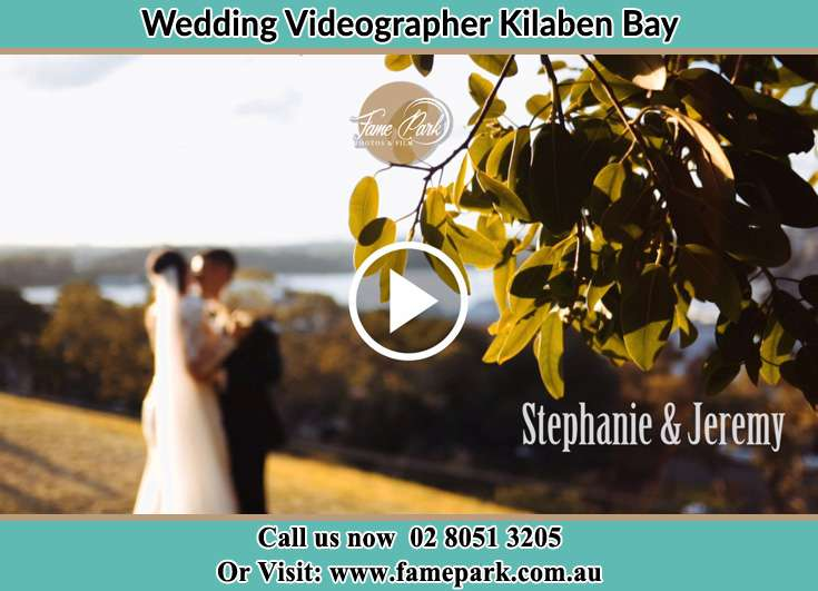 The new couple kissing at the hill Kilaben Bay NSW 2283