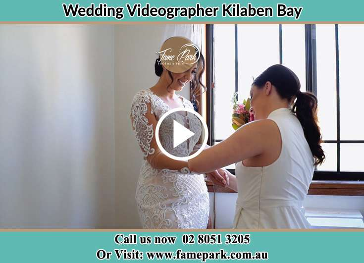Bride getting ready through the help of her secondary sponsor Kilaben Bay NSW 2283