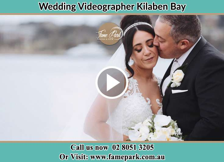 Bride and Groom kissed at the shore Kilaben Bay NSW 2283