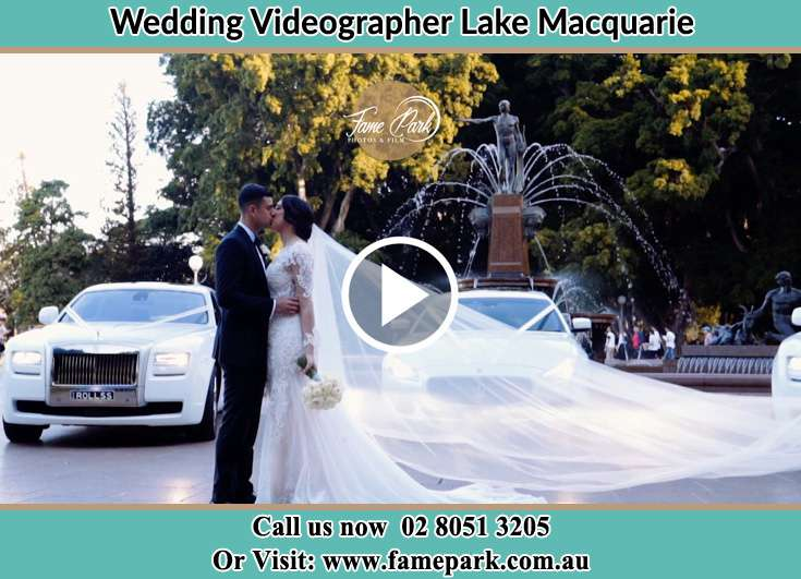 The Bride And Groom Kiss In Front Of The Bridal Car Lake Macquarie