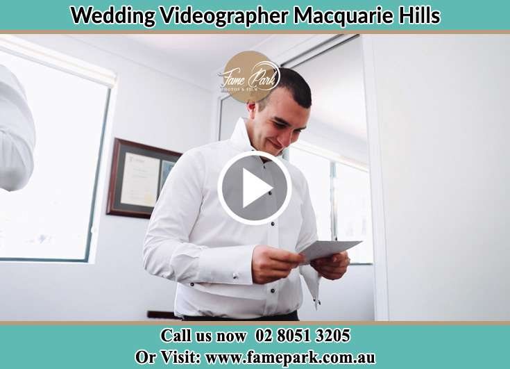 The Groom reading a note Macquarie Hills NSW 2285