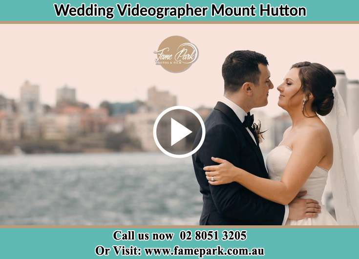 Bride and Groom kissed at the shore Mount Hutton NSW 2290