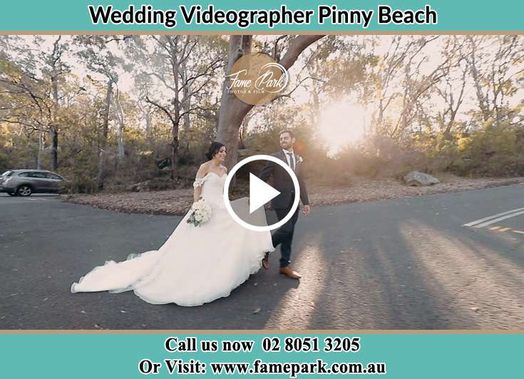 The Groom and the Bride walking in the street Pinny Beach NSW 2281
