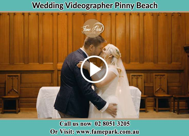 The Groom and the Bride kissing Pinny Beach NSW 2281
