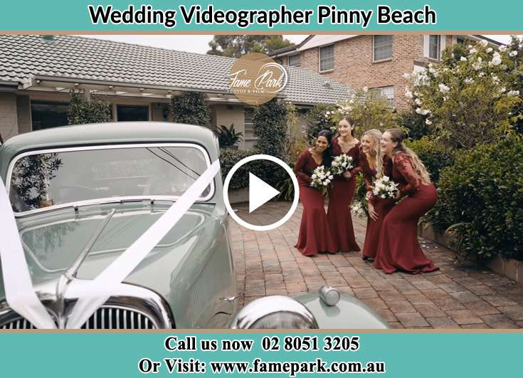 The bridesmaids near the wedding car Pinny Beach NSW 2281