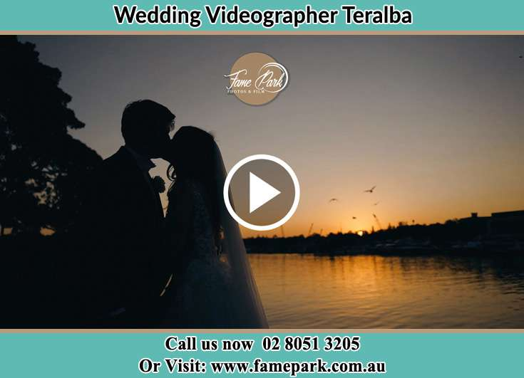 Bride and Groom kissed at the shore Teralba NSW 2284
