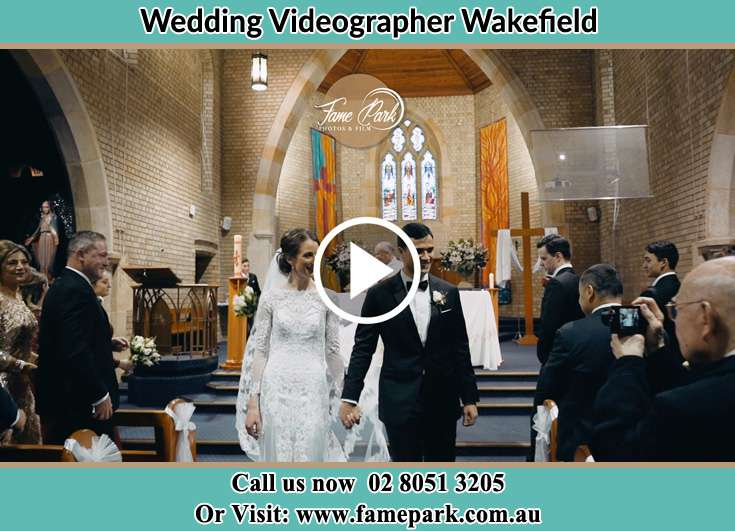 The newly weds walking through the well wishers Wakefield NSW 2278