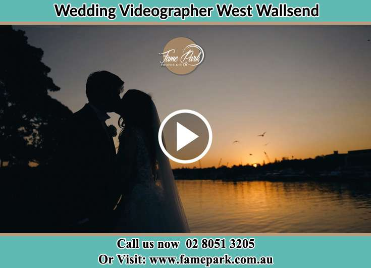 Bride and Groom kissed at the shore West Wallsend NSW 2286