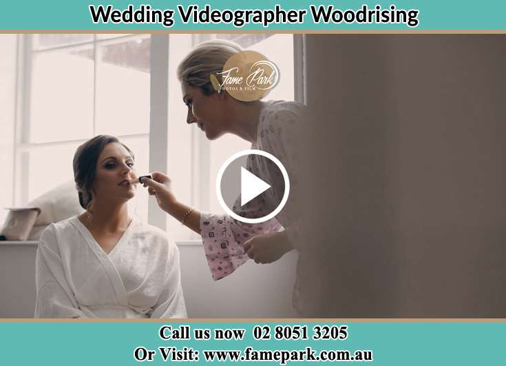 The Bride having a make-up with the help of the makeup artist Woodrising NSW 2284