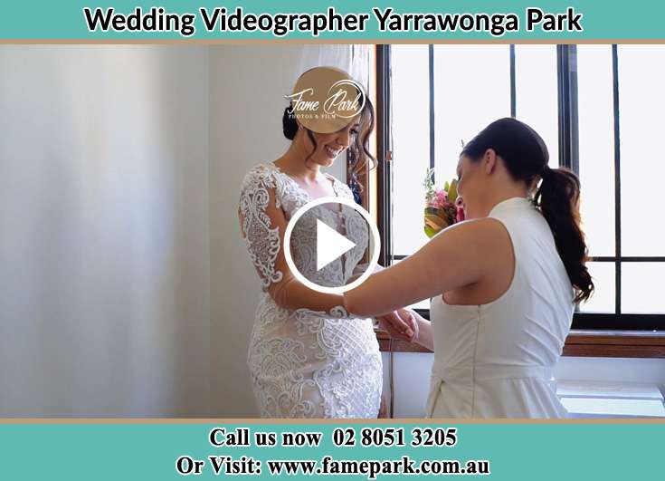 Bride getting ready through the help of her secondary sponsor Yarrawonga Park NSW 2264